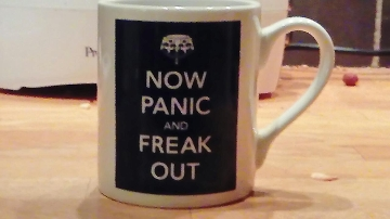 mug  saying now panic and freak out